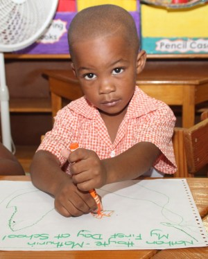 It was Nathan Hoyte-Mathurin's first day at St Giles Nursery.