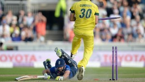 James Taylor dives in to make his ground and complete his first ODI century.