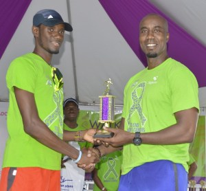 Oein Josiah was presented with his trophy and prizes by Anderson King, vice-president of marketing at Sagicor Life.