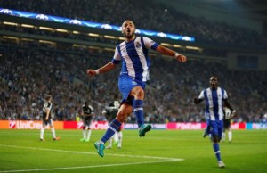 Porto's Andre Andre celebrates after scoring against Chelsea.
