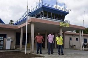 Prime Minister Roosevelt Skerrit (centre) outside the arrival hall.