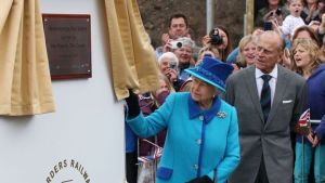 Queen Elizabeth II unveiling a plaque at Newtongrange station.
