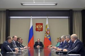 Russia's President Vladimir Putin (centre) chairing a meeting with members of the Security Council at the Novo-Ogaryovo state residence outside Moscow, Russia, yesterday