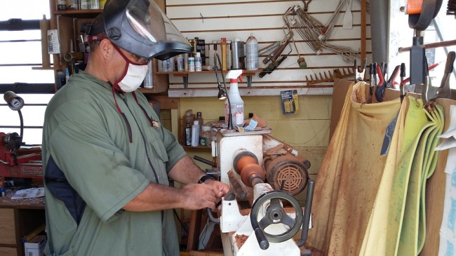 Steve Carter on his lathe fashioning one of his masterpieces.