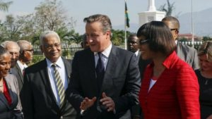 David Cameron with Jamaica's PM Portia Simpson Miller, says he wants to look to the future.