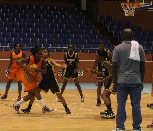Tiffany Husbands of St John Sonics was under heavy guard by Hoopsters.