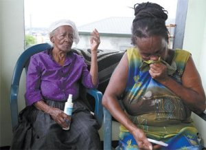 Yakini Charles' grandmother, Lucille Lanye, right, and great grandmother, Lanthe, at their Belmont home yesterday.