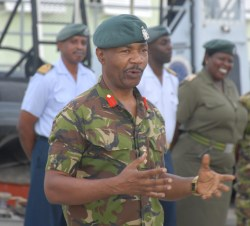 Colonel Alvin Quintyne addressing the contingent on return to Barbados today.