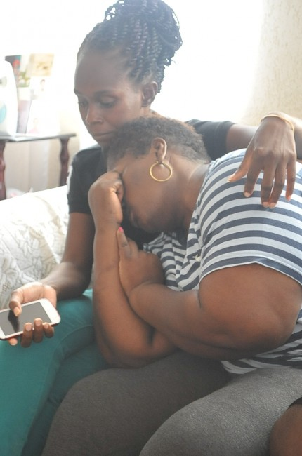 Waveney's mom was too distraught to speak to the media. Here she is comforted by a family friend.