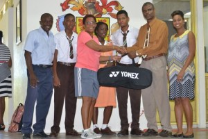 Former badminton national player Caroline Vaughan (third left) was all smiles as she presented Frederick Smith Secondary's principal Jefferson Phillips with the sports gear.