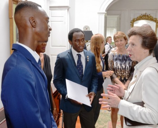 Princess Anne chatting with Akeem James and Chad Larrier.