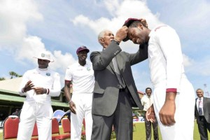 Debutant Jomel Warrican gets his cap from West Indies legend Sir Garfield Sobers a few hours before he claimed his first four Test wickets.
