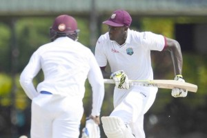 Jason Holder (right) and his team have to make most of the running over the next three days if West Indies are ro draw the series.