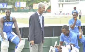 Sir Garfield Sobers having a word with Marlon Samuels after a net session.