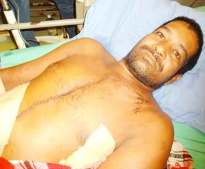 Stabbed by his wife Daniel Persaud lies in bed in the High Dependency Unit.