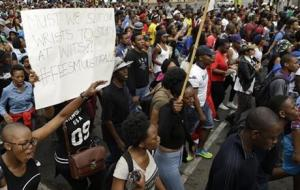 University of the Witwatersrand students marching during their protest in Johannesburg, South Africa, today.