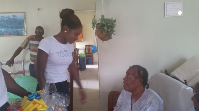 Sales Associate Omisa Hobbs greeting Erminia Clarke after delivering a hamper.