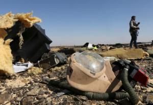 Debris from a Russian airliner  at its crash site at the Hassana area  in Arish city, north Egypt, yesterday.