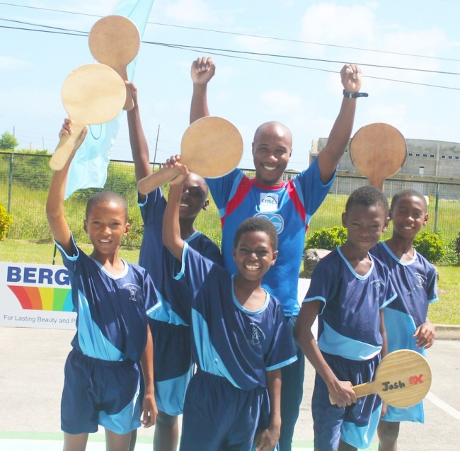 Belmont Primary winners of zone six of the National Primary Schools Road Tennis Championship took time to pose with their mentor and Barbados undisputed number one road tennis king Mark 'Venom' Griffith. (Pictures by Morissa Lindsay.)