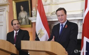 Britain's Prime Minister David Cameron (right) speaking during a news conference with Egypt's President Abdel Fattah al-Sisi at Number 10 Downing Street in London, Britain, today.