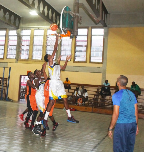 Combermere's Jehu Lafeuillee goes for another lay-up during his 28 points performance against the Barbados Community College.