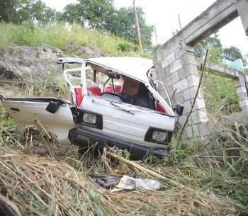 The van driven by Anthony Bentham tumbled about 40 feet down a ravine after being struck by another vehicle.