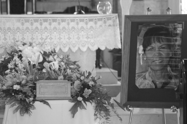 A picture of Marcelle Smith (at right) resting beside the urn where her ashes are stored.