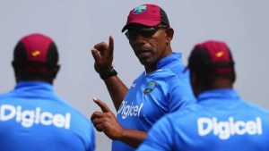 Phil Simmons (centre) has been recalled to the management structure of the Windies' team.