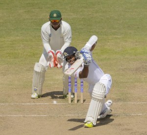 Shai Hope drives gracefully for another boundary during his half-century.