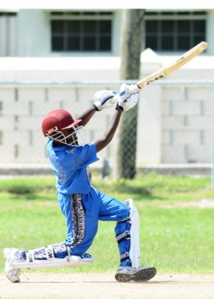 Macaiah Simmons plays a delightful lofted drive during his unbeaten half-century. (Pictures by Alric Gaskin)