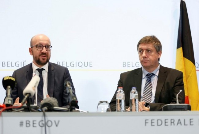 """Belgium's Prime Minister Charles Michel (L) and Interior Minister Jan Jambon (R) address a news conference in Brussels, November 21, 2015, after security was tightened in Belgium following the fatal attacks in Paris. Belgium raised the alert status for its capital Brussels to the highest level on Saturday, shutting the metro and warning the public to avoid crowds because of a """"serious and imminent"""" threat of an attack.  REUTERS/Francois Lenoir"""