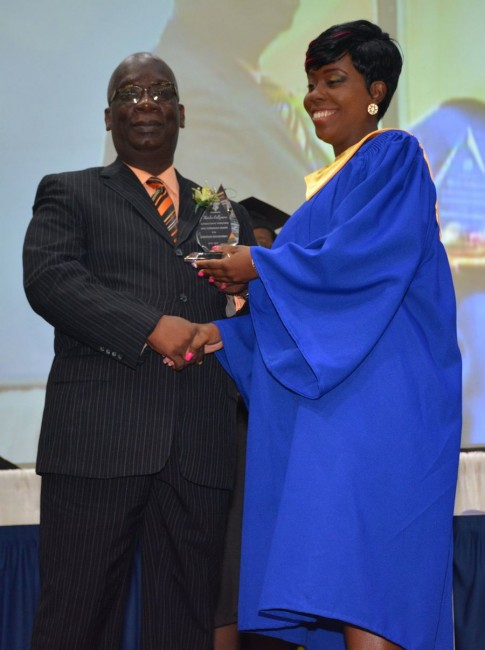 Special awardee Keisha Collymore receives her award from Minister of Education Ronald Jones.