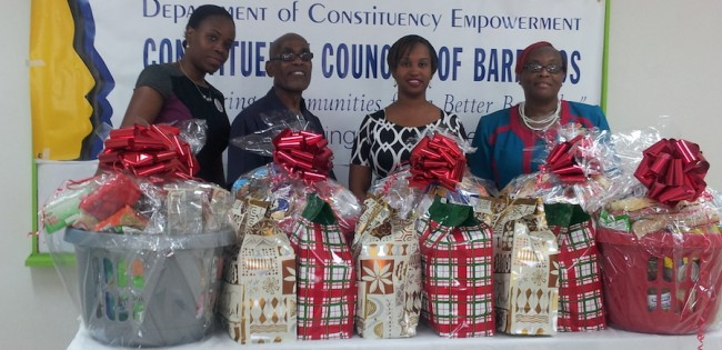 (From left) Latoya Kinch of Clarke Gittens Farmer firm, Member of the St Michael South East Constituency Tennyson Drakes, Lisa Lewis-Sealy and Shirley Small from the Department of Constituency Empowerment during the handing over of the hampers.