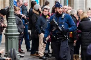 An armed policeman patroling at the Grand Place in Brussels yesterday.