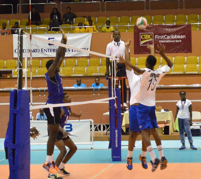Barbados' Paul Doughty (left) going up to deny Elman Eniona at the net.