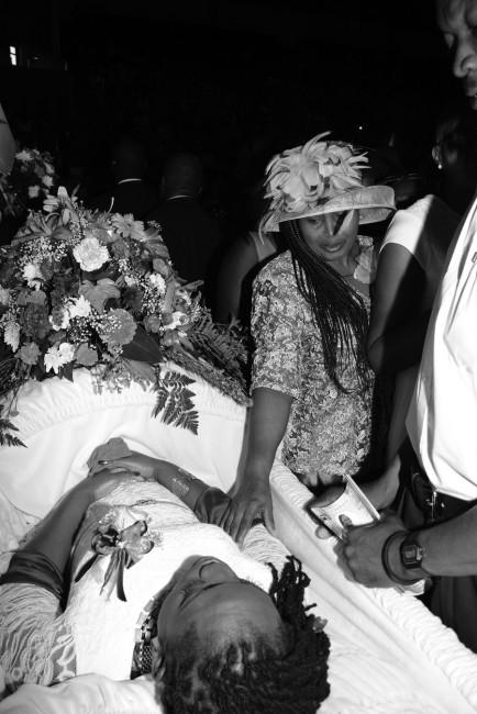 A mourner saying goodbye to Shakira Shepherd.