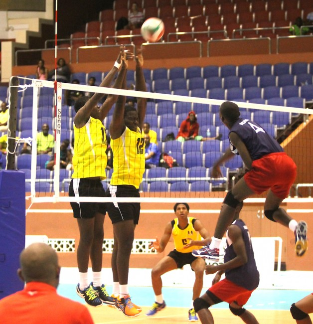 Haiti outisde hitter Judenel Paul goes high to score pass Barbados defense of Akeem Mayers and Shamar Bishop