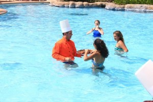 General manager George Stanfield giving out some goodies in the pool.