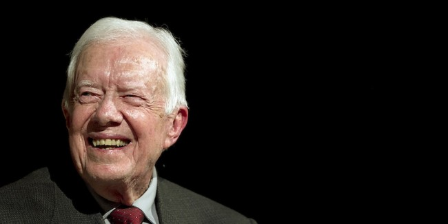 Former U.S. President Jimmy Carter speaks with Mark Updegrove, director of the Lyndon B. Johnson Presidential Library in Austin, on the first day of the Civil Rights Summit, Tuesday, April 8, 2014, in Austin, Texas. (AP Photo/Statesman.com, Ralph Barrera, Pool)