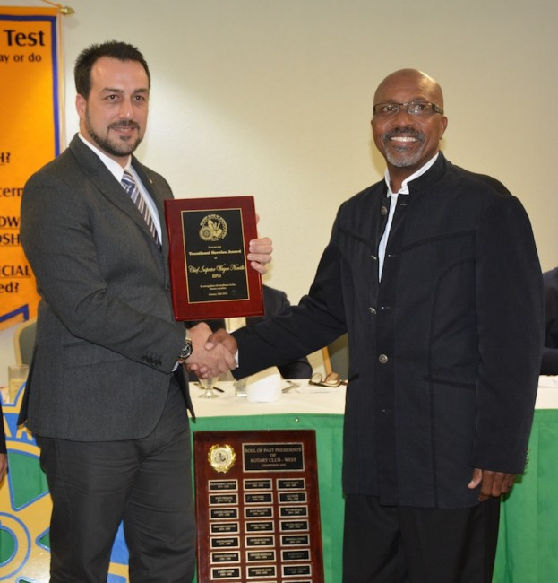 Awardee Wayne Norville (at right) receiving his plaque from Rotary West president  Farid Mansoor.