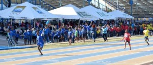 Blue House celebrate as Omarion Ifill anchors them to victory in the Boys U-13 4x100m relay.