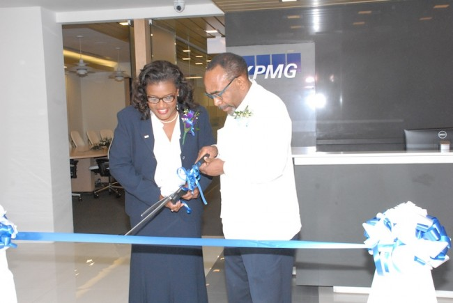 Senator Darcy Boyce (right) and Managing Director of KPMG Carol Nicholls (left) cutting the ribbon to celebrate the re-launch of the renovated KPMG building.