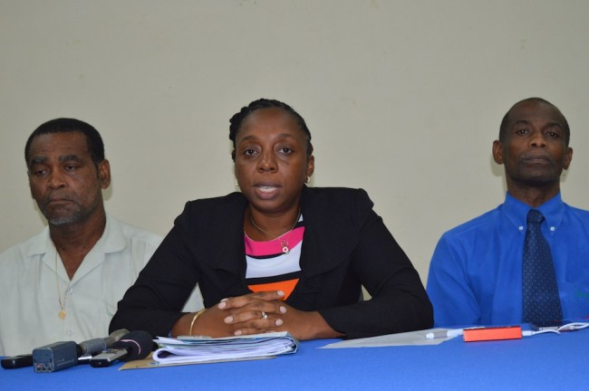 BWU General Secretary Toni Moore (center) speaking to reporters while flanked by President of the BWA division Carl Boyce (left) and Vice President Winston Roach.