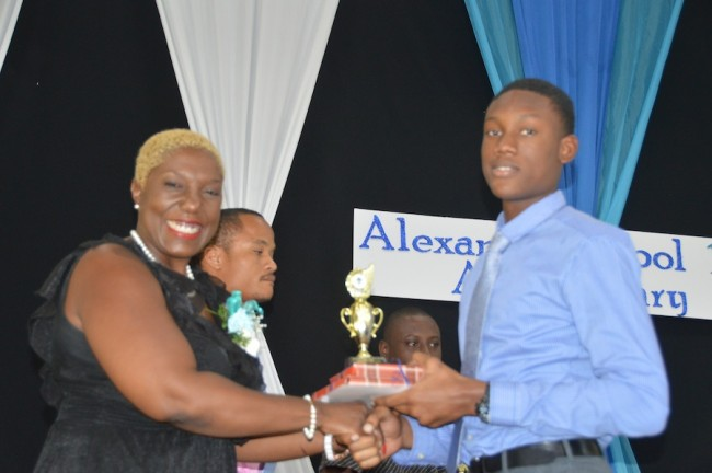 Most Outstanding Boy at the CSEC level, Antonio Payne, receiving his award from Alexandra Old Scholars' Association president Sandra Denny.