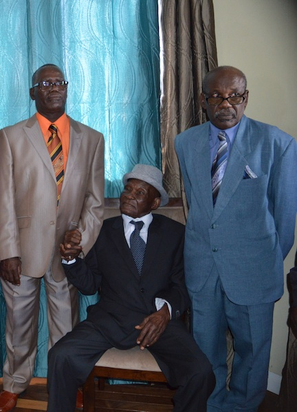 Centenarian Eustace Layne flanked by his sons David Bynoe (left) and Merlan Yarde (right).