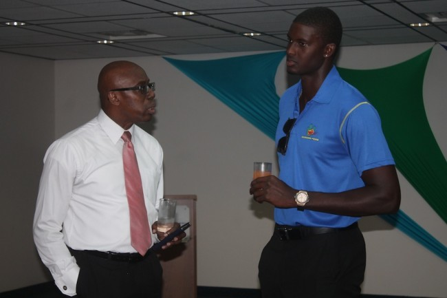 (From left) Interim chief executive officer of the National Sports Council and Gymnasium Limited, Jerry Blenman, in conversation with West Indies and Barbados captain, Jason Holder  at the airport yesterday. (Picture by Morissa Lindsay)
