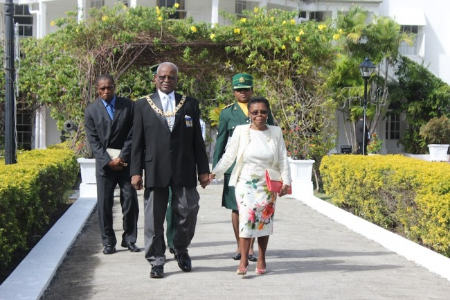Governor General Sir Elliott Belgrave and Lady Belgrave making their way to today's National Honours ceremony.