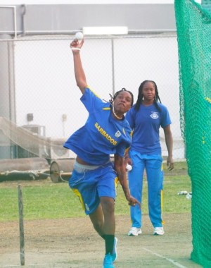 Barbadian spin bowler Nadia Rose-Hinds sends down another impressive delivery under the watchful eyes of successful Barbados captain Shaquana Quintyne. (Pictures by Morissa Lindsay)