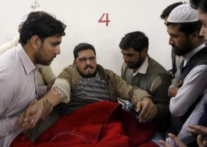 Relatives and friends surrounding a man injured in a militant attack  at Bacha Khan University, at a hospital in Charsadda, Pakistan, today.