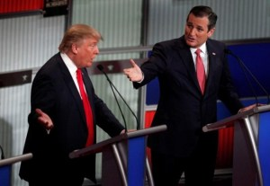 Republican US presidential candidate businessman Donald Trump (left) and Senator Ted Cruz speaking simultaneously at the Fox Business Network Republican presidential candidates debate in North Charleston, South Carolina, today.